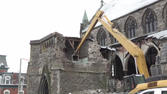 Demolition has begun on the historic Saint John Gothic Arches drawing a large crowd of onlookers.  Laura Lyall reports.
