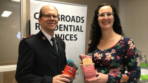 Stephanie Fox, a chiropractor in Saskatoon, is pictured with Major Mike Hoeft, area commander with the Salvation Army. (Carla Shynkaruk/CTV Saskatoon)