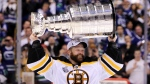 Boston Bruins goalie Tim Thomas hoists the cup following his teams 4-0 win over the Vancouver Canucks in game 7 of the NHL Stanley Cup Final at Rogers Arena in Vancouver, Wednesday, June 15, 2011. (THE CANADIAN PRESS / Jonathan Hayward)