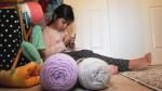 Sophia Karmali is shown knitting in her home in Burnaby, B.C., on Thursday, Dec. 12, 2019.