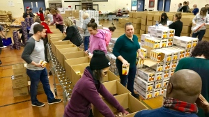 About 60 volunteers filled an Edmonton school gym on Dec. 12, 2019, to pack 1,300 food hampers for Edmontonians in need during the holidays.