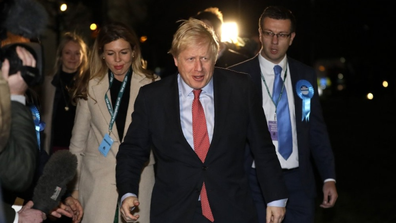 Britain's Prime Minister and Conservative Party leader Boris Johnson and his partner Carrie Symonds arrives for the Uxbridge and South Ruislip constituency count declaration at Brunel University in Uxbridge, London, Friday, Dec. 13, 2019. (AP Photo/Kirsty Wigglesworth)