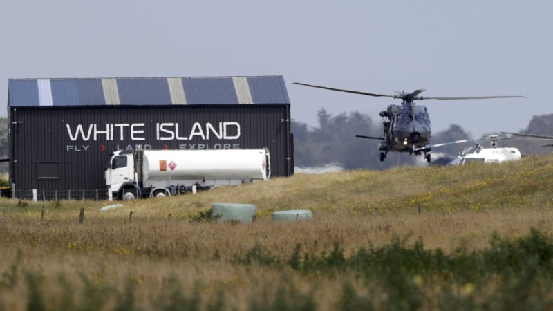A Navy helicopter returns to Whakatane Airport following the recovery operation to return the victims of the Dec. 9 volcano eruption continues off the coast of Whakatane New Zealand, Friday, Dec. 13, 2019. (AP Photo/Mark Baker)
