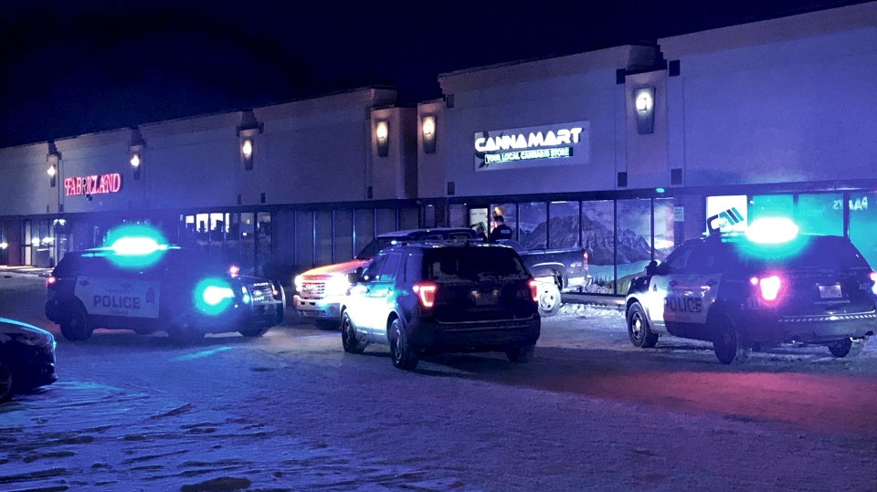 Police vehicles surround a west Edmonton CannaMart, and an empty pick-up truck. Dec.12, 2019. (CTV News Edmonton)