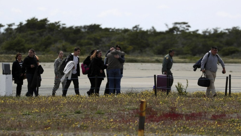 Relatives of passengers of a missing military plane arrive to an airbase in Punta Arenas, Chile, Wednesday, Dec. 11, 2019. (AP Photo/Fernando Llano)