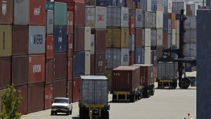 FILE - In this July 22, 2019, file stacked containers wait to be loaded on to trucks at the Port of Oakland in Oakland, Calif. (AP Photo/Ben Margot, File)