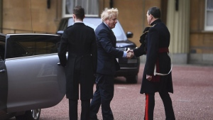 Britain's Prime Minister Boris Johnson arrives at London's Buckingham Palace for an audience with Britain's Queen Elizabeth II after the Conservative Party returned to power in the General Election with an increased majority, in London, Friday, Dec. 13, 2019. (Victoria Jones/Pool Photo via AP)