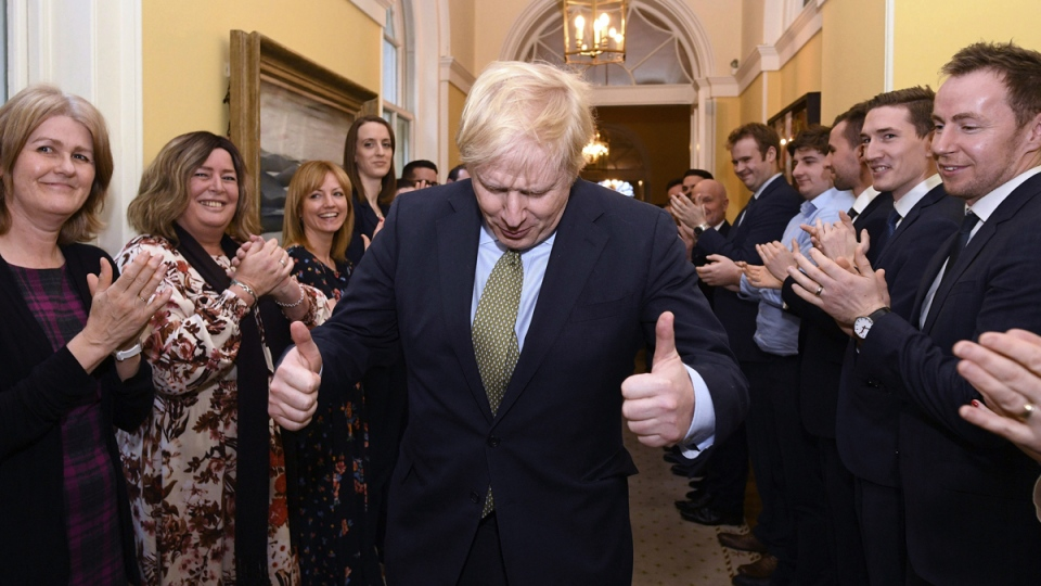 Boris Johnson is greeted by staff at 10 Downing St