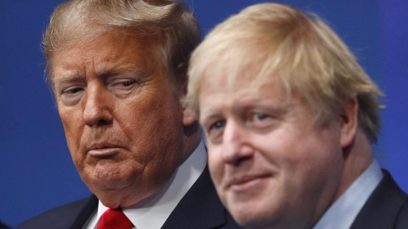 British Prime Minister Boris Johnson, right, and U.S. President Donald Trump at The Grove hotel and resort in Watford, Hertfordshire, England, on Dec. 4, 2019. (Peter Nicholls, Pool Photo via AP)