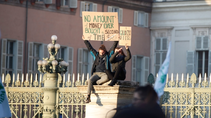 Students attend a climate march, with the participation of Swedish environmental activist Greta Thunberg, in Turin, Italy, Friday. Dec. 13, 2019. (AP Photo/Antonio Calanni)