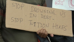 The protest sign of a U of C graduate student during Friday's U of C Board of Governors meeting