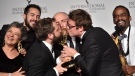 "Writer Fabio Porchat, second from right, poses with the ""Especial de Natal Porta dos Fundos,"" team in celebration of their best comedy award win during the 47th International Emmy Awards gala at the Hilton New York, Monday, Nov. 25, 2019, in New York. (Photo by Evan Agostini/Invision/AP)"
