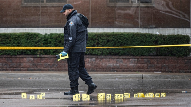 Police investigate the scene of a shooting in a parking lot in the west-end of Toronto, on the morning of Thursday, Oct., 31, 2019. The shooting happened close to another shooting from the previous evening. THE CANADIAN PRESS/Christopher Katsarov