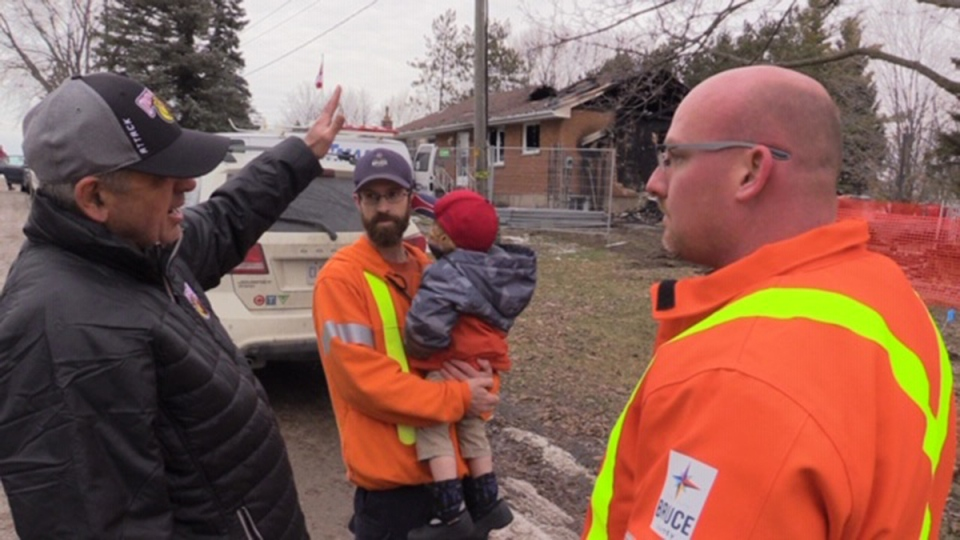 Homeowner Dale Steinhoff, left, talks to his snow plow heroes, Andrew Yule and Jeremy Gowan, in Paisley, Ont. on Friday, Dec. 13, 2019. (Scott Miller / CTV London)