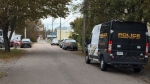 A Cape Breton Regional Police forensic unit van sits outside a Cottage Street residence in Sydney where a four-month-old boy died on Oct. 9. (CTV ATLANTIC / KYLE MOORE)