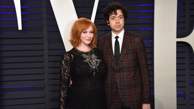 In this Feb. 24, 2019 file photo, Christina Hendricks, left, and Geoffrey Arend arrive at the Vanity Fair Oscar Party in Beverly Hills, Calif. (Photo by Evan Agostini/Invision/AP, File)