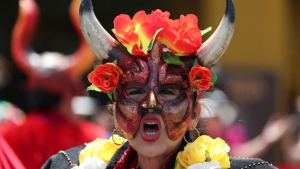 A dancer of the Carnival of Riosucio, also known as the Carnival of the Devil, performs during the annual meeting of the UNESCO's Intergovernmental Committee for the Safeguarding of the Intangible Cultural Heritage, in Bogota, Colombia, Tuesday, Dec. 10, 2019. During six days the Committee have to decide on six requests for inscription on the list of intangible cultural Heritage in need of urgent safeguarding. (AP Photo/Fernando Vergara)
