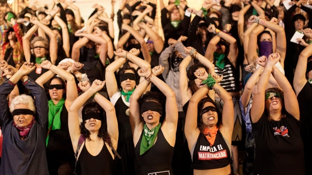 """Women perform the feminist anthem, """"Un violador en tu camino"""" or """"A rapist in your path,"""" in a demonstration against gender-based violence, at Cinelandia Square, in Rio de Janeiro, Brazil, Tuesday, Dec. 3, 2019. The blindfolded women chant the words that include: """"The fault wasn't mine, nor where I was, nor how I was dressed. You're the rapist,"""" originated by the Chilean feminist collective Las Tesis. (AP Photo/Silvia Izquierdo)"""