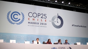 Chilean Environment Minister and chair of COP25 Carolina Schmidt, sitting 2nd left, take part at the COP25 climate talks congress in Madrid, Spain, Saturday, Dec. 14, 2019. (AP Photo/Manu Fernandez)