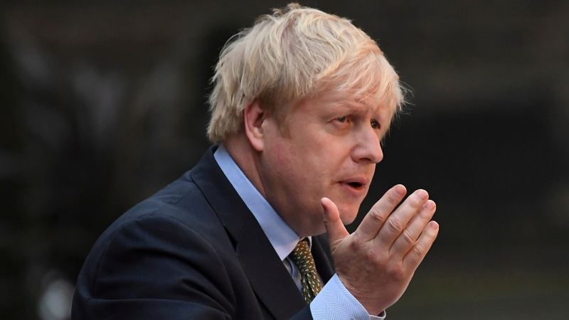 Britain's Prime Minister Boris Johnson speaks outside 10 Downing Street in London on Friday, Dec. 13, 2019. (AP Photo/Alberto Pezzali)