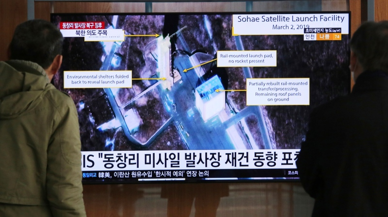 In this March 6, 2019, file photo, people watch a TV screen showing an image of the Sohae Satellite Launching Station in Tongchang-ri, North Korea, during a news program at the Seoul Railway Station in Seoul, South Korea. (AP Photo/Ahn Young-joon)