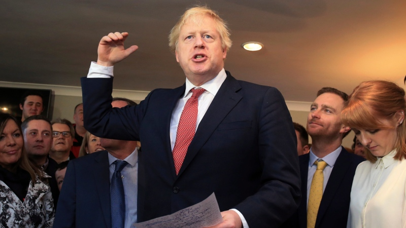 Britain's Prime Minister Boris Johnson gestures as he speaks to supporters during a visit to meet newly elected Conservative party lawmakers at Sedgefield Cricket Club in County Durham, north east England on Saturday Dec. 14, 2019, following his Conservative party's general election victory. (Lindsey Parnaby / Pool via AP)