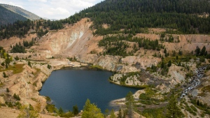 This Sept. 19, 2018 photo shows the Yellow Pine Pit open-pit gold mine in the Stibnite Mining District in central Idaho, where a company hopes to start mining again. Documents show the Trump administration intervening in a U.S. Forest Service decision so that a Canadian company could write a key environmental report on its proposed open-pit gold mines in central Idaho. (Riley Bunch/Idaho Press-Tribune via AP)