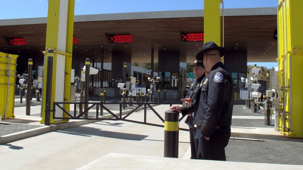 In this May 8, 2019 photo, U.S. Customs and Border Protection officials stand at the new border crossing facility on the U.S.-Canadian border in Derby Line, Vt. Court documents say federal agents seized almost 370 pounds (166.6 kilos) of cocaine that was hidden in a truck that was preparing to enter Canada at the Derby Line border crossing on Dec. 7. (AP Photo/Wilson Ring, File)
