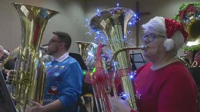 Tuba players play festive Christmas show