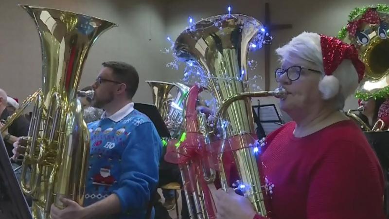 Tuba players play festive Christmas show