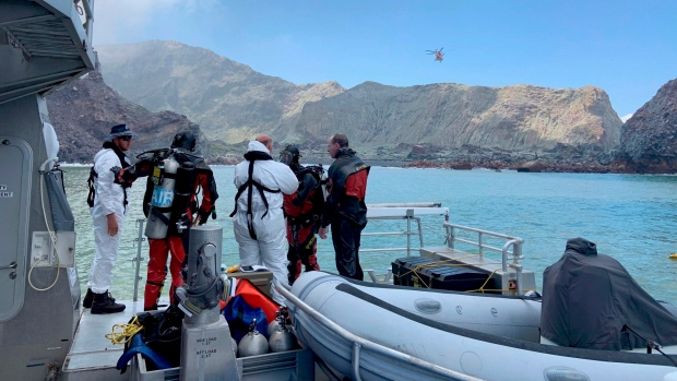 Police divers prepare to search the waters near White Island off the coast of Whakatane, New Zealand, Saturday Dec. 14, 2019. (New Zealand Police via AP)