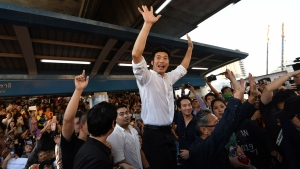 Thailand's Future Forward Party leader Thanathorn Juangroongruangkit talks to his supporters during rally in Bangkok, Thailand, Saturday, Dec. 14, 2019. (AP Photo/Str)