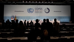 COP25 party members talk ahead of the closing plenary in Madrid, Sunday Dec. 15, 2019. (AP Photo/Bernat Armangue)