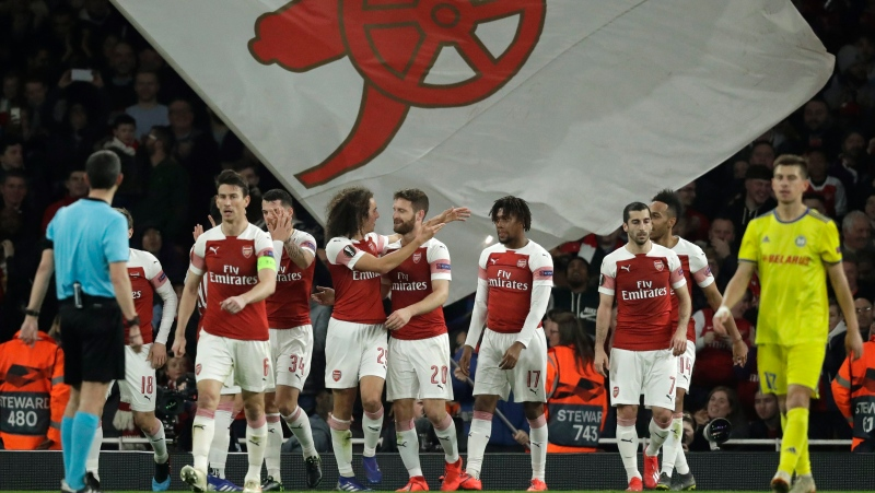 Aresenal players celebrate after Arsenal's Shkodran Mustafi scored his side's second goal during the Europa League round of 32 second leg soccer match between Arsenal and Bate at the Emirates stadium in London, Thursday, Feb. 21, 2019. (AP Photo/Matt Dunham)