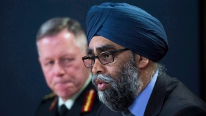 Defence Minister Harjit Sajjan speaks at an announcement on fighter jets as General Jonathan Vance, Chief of the Defence Staff (left) looks on at the National Press Theatre in Ottawa on Tuesday, Dec. 12, 2017. (THE CANADIAN PRESS / Sean Kilpatrick)