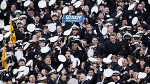 Navy midshipmen celebrate a touchdown during the first half of an NCAA college football game against Army, Saturday, Dec. 14, 2019, in Philadelphia. (AP Photo/Matt Slocum)