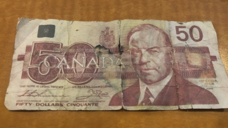 Someone dropped a counterfeit $50 bill in the donation bin at a Burnaby RCMP fundraiser last week. (Burnaby RCMP/Twitter)