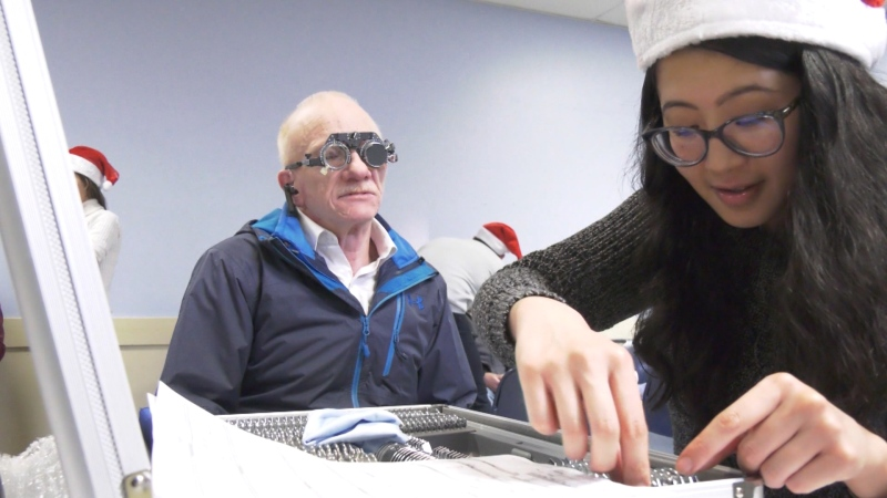 Volunteers help DTES residents get glasses
