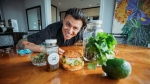 Pat Newton poses in front of his ingredients for a cannabis-infused dish. (sociophilo/Sandro Pehar)