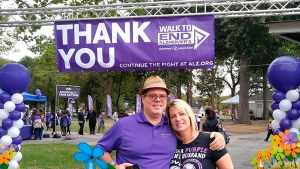 This undated image released by the Alzheimer's Association shows Kim and Jeff Borghoff, pose at a fundraising event for the Alzheimer's Association. For Kim Borghoff and her family, keeping a tradition of Sunday meals helped maintain a sense of normalcy as her husband and his father were simultaneously struggling with Alzheimer's disease. (Hugh Acheson/Alzheimer's Association via AP)