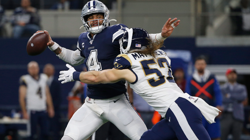 Dallas Cowboys quarterback Dak Prescott (4) passes under pressure from Los Angeles Rams outside linebacker Clay Matthews (52) in the first half of an NFL football game in Arlington, Texas, Sunday, Dec. 15, 2019. (AP / Ron Jenkins)