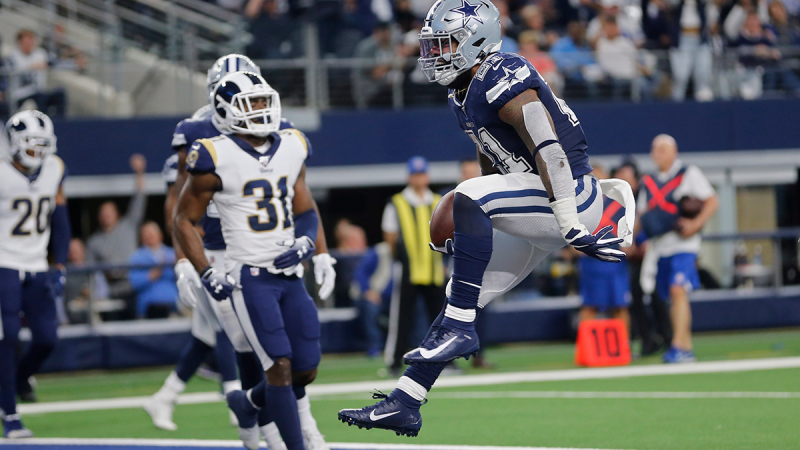 Dallas Cowboys running back Ezekiel Elliott (21) jumps into the end zone with a touchdown in front of Los Angeles Rams defensive back Darious Williams (31) in the first half an NFL football game in Arlington, Texas, Sunday, Dec. 15, 2019. (AP / Michael Ainsworth)
