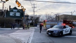 Authorities investigate after a young girl was struck by a fire truck in Toronto. (Peter Muscat)