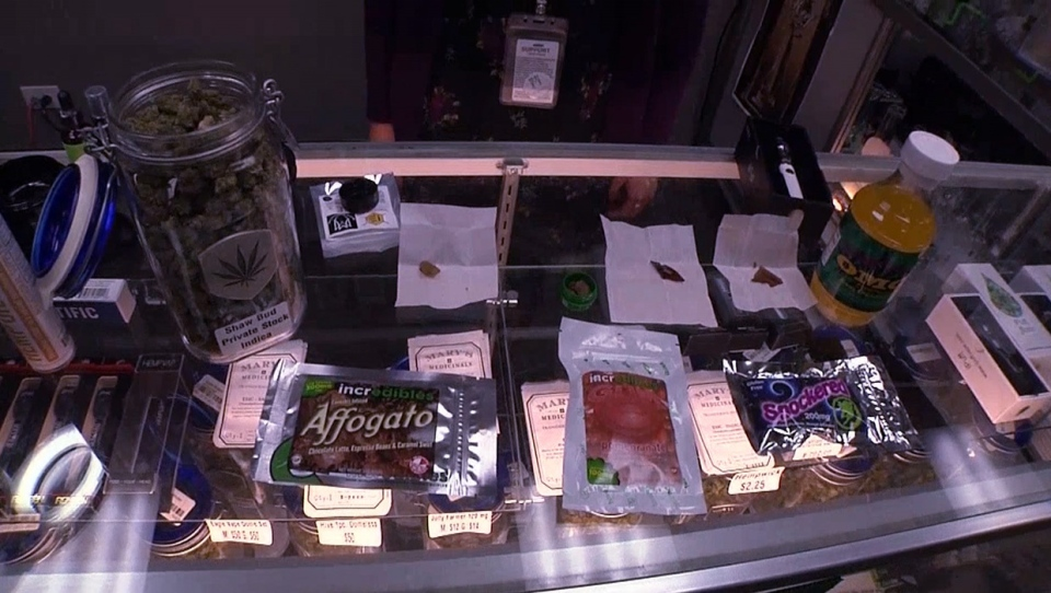 Edible cannabis products, which are now available for sale at stores in select Canadian provinces, on a display case (file)