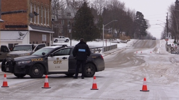 Police block the roadway in Tara, Ont. during a standoff on Tuesday, Dec. 17, 2019. (Scott Miller / CTV London)