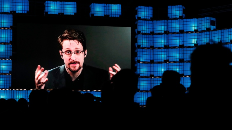 FILE - In this Nov. 4, 2019, file photo, former U.S. National Security Agency contractor Edward Snowden addresses attendees through video link at the Web Summit technology conference in Lisbon. (AP Photo/Armando Franca, File)