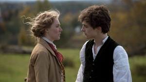 "This image released by Sony Pictures shows, Saoirse Ronan and Timothée Chalamet in a scene from ""Little Women."" (Wilson Webb/Sony Pictures via AP)"