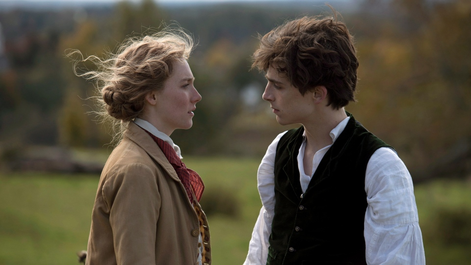 This image released by Sony Pictures shows, Saoirse Ronan and Timothée Chalamet in a scene from