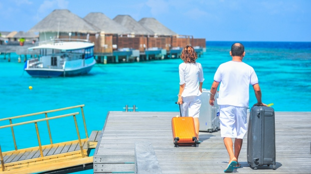Man and woman walking on a dock