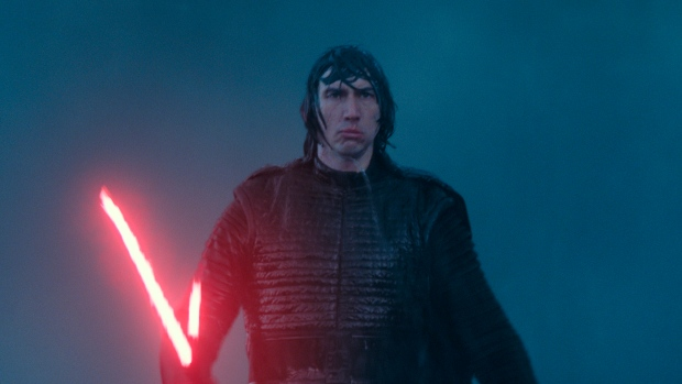 "This image released by Disney/Lucasfilm shows Adam Driver as Kylo Ren in a scene from ""Star Wars: The Rise of Skywalker."" (Disney/Lucasfilm Ltd.)"